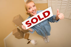 Woman and Doggy with Sold Sign Near Moving Boxes Stock Photos