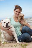 Woman with dogs. Happy young woman walking with dogs Royalty Free Stock Photography
