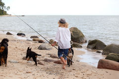 Woman with dogs. Woman with her dogs on sea beach walking Stock Photos