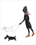 Woman with dogs. Illustration  in doodle style of a modern woman walking with two small dogs on the leads Royalty Free Stock Images