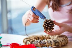 The woman doiing diy festive decorations at home. Woman doiing DIY festive decorations at home Stock Images