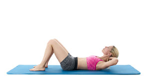 Woman doing ab crunches Stock Photo