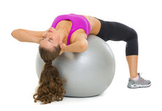 Woman doing abdominal crunch on fitness ball Royalty Free Stock Images