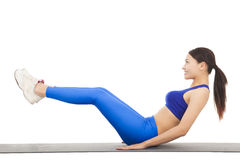 Woman doing abdominal crunches on exercise royalty free stock photo