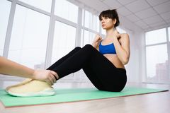 Woman doing abdominal crunches to get six-pack abs. Interval training, healthy lifestyle, sport, weight loss, tabata, endurance, perfect shape. Sportswoman doing stock photo
