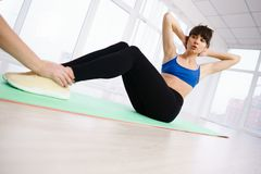 Woman doing abdominal crunches to get six-pack abs. Weight loss, tabata, endurance, perfect shape. Sportswoman doing abdominal crunches to get six-pack abs stock photo