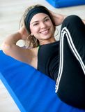 Woman doing abdominals Royalty Free Stock Photography