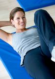 Woman doing abs Royalty Free Stock Photos