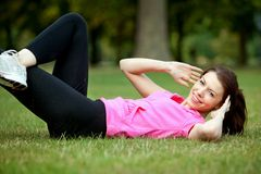 Woman doing abs Stock Photography