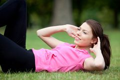 Woman doing abs Royalty Free Stock Photo