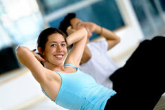 Woman doing abs Royalty Free Stock Photography