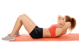 Woman doing abs crunches on a mat Stock Photography