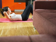 Woman doing abs exercise at home Royalty Free Stock Images