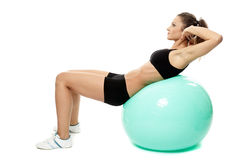 Woman doing abs on gym ball Stock Images