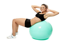 Woman doing abs on gym ball Royalty Free Stock Photos