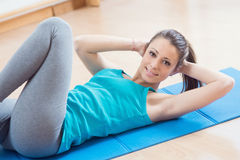 Woman doing abs workout at gym stock images
