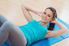 Woman doing abs workout at gym Stock Photos