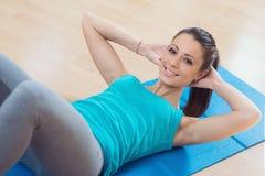 Woman doing abs workout at gym stock photos