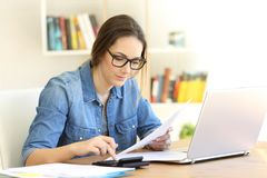 Woman doing accounting at home stock photos