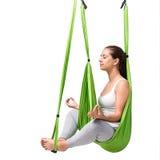 Woman doing aerial antigravity yoga isolated. Stock Photos