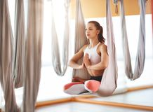 Woman doing of Aero yoga of antigravity in hammock. Woman doing of Aero yoga of antigravity in a hammock stock images