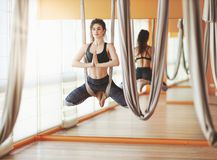 Woman doing of Aero yoga of antigravity in hammock. Woman doing of Aero yoga of antigravity in a hammock stock photo
