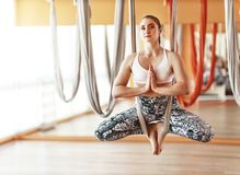 Woman doing of Aero yoga of antigravity in  hammock. Woman doing of Aero yoga of antigravity in a hammock royalty free stock photos