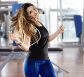 Woman doing aerobics at the gym Stock Photography