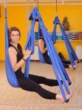 Woman doing anti gravity Aerial yoga Stock Photo