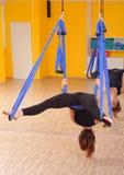 Woman doing anti gravity Aerial yoga Stock Images