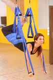 Woman doing anti gravity Aerial yoga Royalty Free Stock Photography
