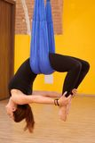 Woman doing anti gravity Aerial yoga Royalty Free Stock Image