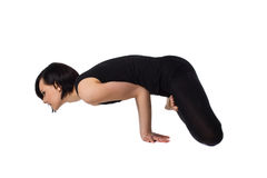 Woman doing arm balance yoga side view Stock Photo