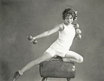 Woman doing arm exercises on vaulting horse Royalty Free Stock Images