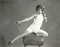 Woman doing arm exercises on vaulting horse Royalty Free Stock Photos