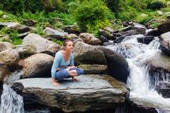 Woman doing  Ashtanga Vinyasa Yoga  arm balance asana Tolasana Stock Photography