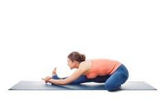Woman doing Ashtanga Vinyasa Yoga asana Janu sirsasana. B - head-to-knee pose B isolated on white background Royalty Free Stock Images