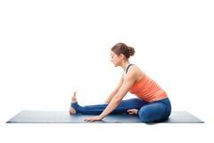 Woman doing Ashtanga Vinyasa Yoga asana Janu sirsasana. Young beautiful sporty fit woman doing Ashtanga Vinyasa Yoga asana Janu sirsasana A - head-to-knee pose A Stock Photos