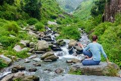 Woman doing Ashtanga Vinyasa Yoga asana Marichyasana D Royalty Free Stock Photos