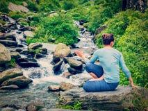Woman doing Ashtanga Vinyasa Yoga asana Marichyasana D Royalty Free Stock Images