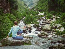 Woman doing Ashtanga Vinyasa Yoga asana Marichyasana D Stock Images