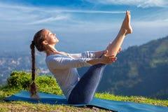 Free Woman Doing Ashtanga Vinyasa Yoga Asana Navasana - Boat Pose Stock Images - 75404514
