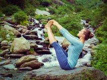 Woman doing Ashtanga Vinyasa Yoga asana outdoors Stock Images