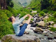 Woman doing Ashtanga Vinyasa Yoga asana outdoors Royalty Free Stock Images