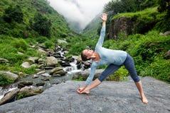 Woman doing Ashtanga Vinyasa yoga asana outdoors Royalty Free Stock Photos