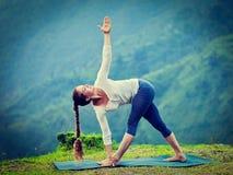 Woman doing Ashtanga Vinyasa yoga asana Parivrtta trikonasana Royalty Free Stock Photography
