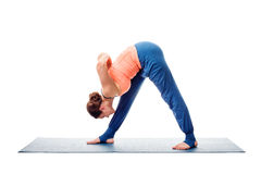 Woman doing Ashtanga Vinyasa Yoga asana Parsvottanasana. Intense side stretch pose isolated on white background Stock Image