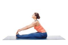 Woman doing Ashtanga Vinyasa Yoga asana Paschimottanasana. Seated forward bend pose isolated on white background Royalty Free Stock Photos