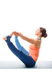 Woman doing Ashtanga Vinyasa yoga asana Upavistha konasana. Beautiful sporty fit woman doing Ashtanga Vinyasa yoga asana Upavistha konasana B - wide sitted Royalty Free Stock Images
