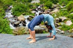 Woman doing Ashtanga Vinyasa Yoga asana Urdhva Dhanurasana  - up Royalty Free Stock Photography